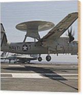 An E-2c Hawkeye Lands Aboard Wood Print by Stocktrek Images