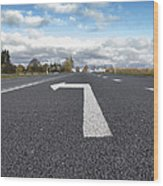 A Metalled Road With A Large Wood Print by Jaak Nilson