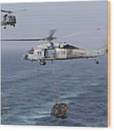 A Mh-60s Knighthawk Transfers Cargo Wood Print by Gert Kromhout