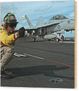 An Airman Gives The Signal To Launch An Wood Print by Stocktrek Images