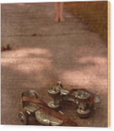 Barefoot Girl On Sidewalk With Roller Skates Wood Print by Jill Battaglia