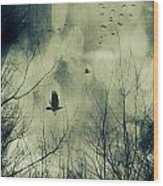 Birds In Flight Against A Dark Sky Wood Print by Sandra Cunningham