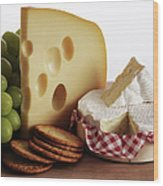 Biscuits, Grapes And Continental Cheeses Wood Print by Simon Battensby
