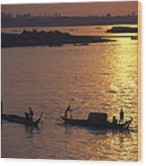 Boats Silhouetted On The Mekong River Wood Print by Steve Raymer