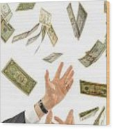 Businessman's Hands Trying To Catch Us Dollars Wood Print by Sami Sarkis