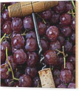 Corkscrew And Wine Cork On Red Grapes Wood Print by Garry Gay