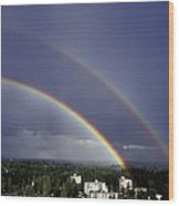 Double Rainbow Over A Town Wood Print by Pekka Parviainen