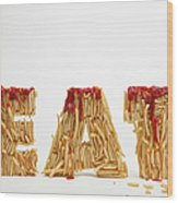 French Fries Molded To Make The Word Fat Wood Print by Caspar Benson
