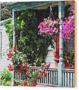 Hanging Baskets And Climbing Roses Wood Print by Susan Savad