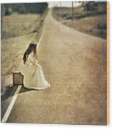 Lady In Gown Sitting By Road On Suitcase Wood Print by Jill Battaglia