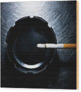 Lit Cigarette And Ashtray On Stainless Steel. Wood Print by Ballyscanlon