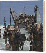 Marines Disembark A Landing Craft Wood Print by Stocktrek Images