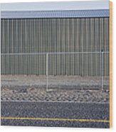 Metal Storage Shed Behind Fence Wood Print by Paul Edmondson