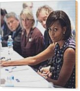 Michelle Obama Attends A Meeting Wood Print by Everett