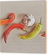 Pepper Dance Wood Print by Elena Kolotusha