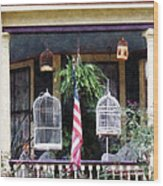 Porch With Bird Cages Wood Print by Susan Savad