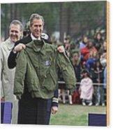 President Bush Displays A Jacket Given Wood Print by Everett