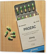 Prozac Pack With Pills On Wooden Surface Wood Print by Damien Lovegrove