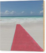 Red Carpet On A Beach Wood Print by Buena Vista Images