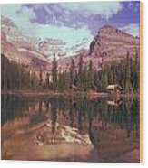 Reflection Of Cabins And Mountains In Wood Print by Carson Ganci