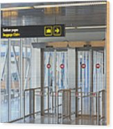 Sign Leading To Baggage Claim Wood Print by Jaak Nilson
