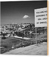 sign overlooking pyla and turkish controlled territory marking entrance of SBA Sovereign Base area Wood Print by Joe Fox