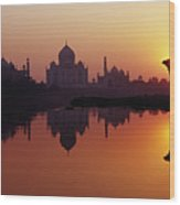 Taj Mahal & Silhouetted Camel & Reflection In Yamuna River At Sunset Wood Print by Richard I'Anson