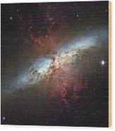 This Galaxy Is Called The Cigar Galaxy Wood Print by ESA and nASA