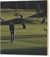 Two People Play Golf While Elk Graze Wood Print by Raymond Gehman