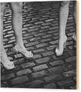 Two Young Women Wearing High Heeled Shoes And Fake Tan On Cobblestones On A Night Out In Dublin  Wood Print by Joe Fox