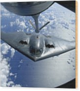 A B-2 Spirit Moves Into Position Wood Print by Stocktrek Images