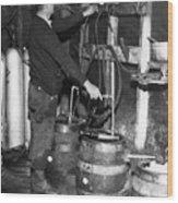 A Brewmeister Fills Kegs At A Bootleg Wood Print by Everett