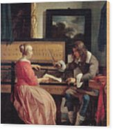 A Man And A Woman Seated By A Virginal Wood Print by Gabriel Metsu