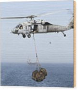 A Mh-60 Helicopter Transfers Cargo Wood Print by Gert Kromhout