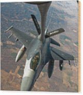 An F-16 Fighting Falcon Receiving Fuel Wood Print by Stocktrek Images