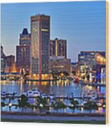 Baltimore Skyline Inner Harbor Panorama At Dusk Wood Print by Jon Holiday