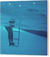 Bare Legs Descending Underwater From The Ladder Of A Boat Wood Print by Sami Sarkis