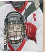 Boys Playing Ice Hockey Wood Print by Ria Novosti