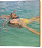 Floating Young Couple Wood Print by Tomas del Amo - Printscapes