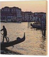 Gondolier In Venice In Silhouette Wood Print by Michael Henderson