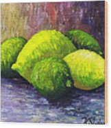 Lemons And Limes Wood Print by Kamil Swiatek