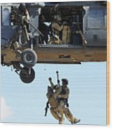 Pararescuemen Are Hoisted Into An Hh-60 Wood Print by Stocktrek Images