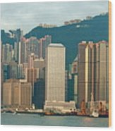 Skyline From Kowloon With Victoria Peak In The Background In Hong Kong Wood Print by Sami Sarkis
