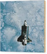 Space Shuttle Orbiting Above Earth Wood Print by Stockbyte