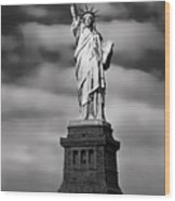 Statue Of Liberty At Dusk Wood Print by Daniel Hagerman