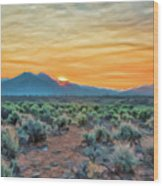 Sunrise Over Taos Wood Print by Charles Muhle