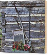 Tall Log Cabin And Garden Tools Wood Print by Linda Phelps