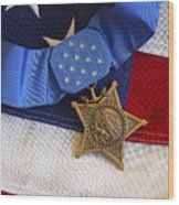 The Medal Of Honor Rests On A Flag Wood Print by Stocktrek Images