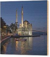 The Ortakoy Mosque And Bosphorus Bridge At Dusk Wood Print by Ayhan Altun