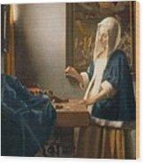 Woman Holding A Balance Wood Print by Jan Vermeer